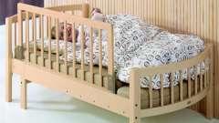 Дитяче ліжко з бортиком для малюків