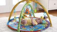 Дитячий розвиваючий килимок - пізнаємо світ з пелюшок